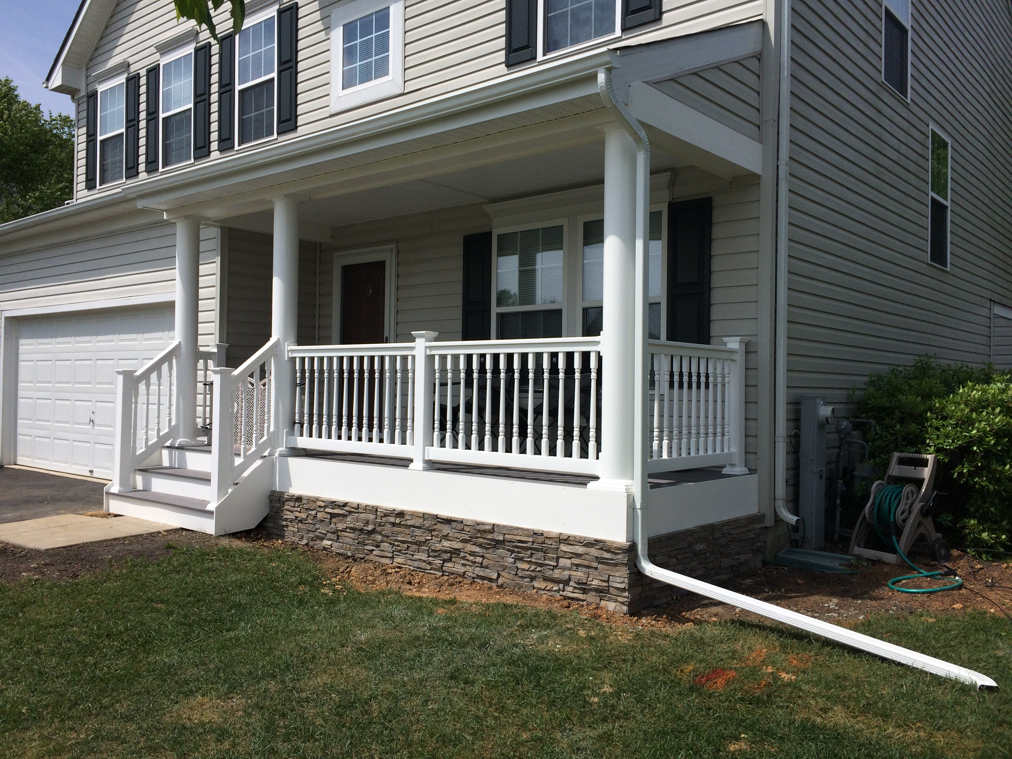 Slate Gray Porch with Round Columns, Lexington Railing, and Stone Siding